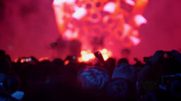 Heads of people standing at rock concert and listening, bright colorful Footage