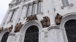 Close view of bronze religious sculptures at white walls of Christian church Footage