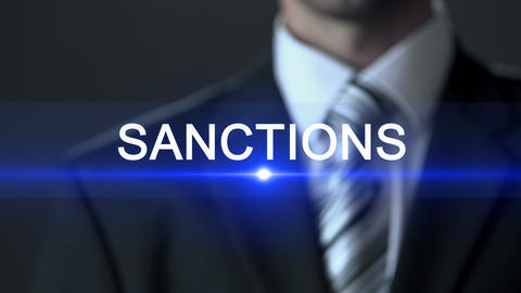 Sanctions, businessman in suit touching screen, danger prevention, prohibition Footage