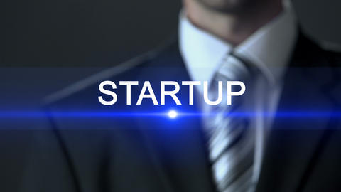Startup, man in business suit pushing buttons on screen, start business, concept Footage