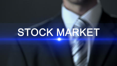 Stock market, male wearing official suit pressing buttons on screen, exchange Footage