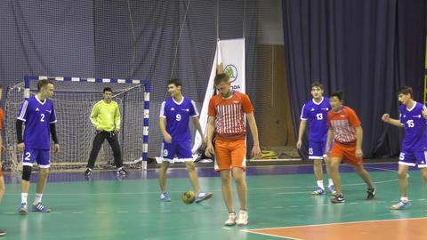 Orenburg, Russia - 11-13 February 2018 year: boys play in handball GIF