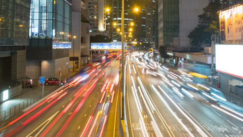 Fast traffic lights streak in city at night, time lapse Footage