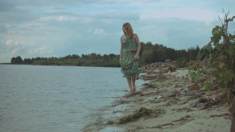 Joyful redhead woman walking along the beach ビデオ