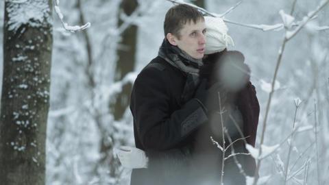 hugs happy couple in winter outdoors Footage