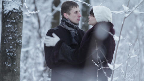 happy couple conversation in the winter outdoors Footage
