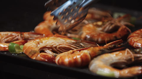 Grilling and fried shrimps on electric barbecue. Healthy Grilled seafood on bbq Footage