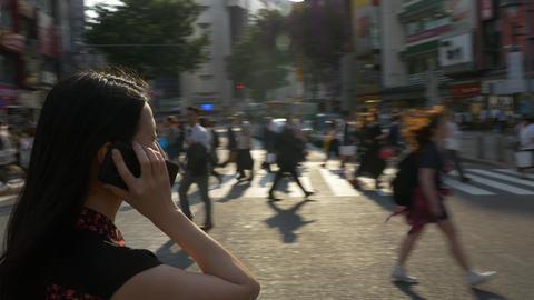 Japanese Woman Talks On Smartphone In Shibuya Crossing In Tokyo Footage