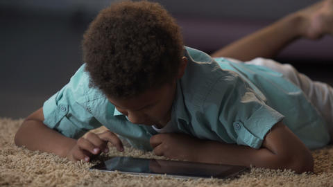 Ignored by parents child surfing on tablet trying to cheering himself up Footage