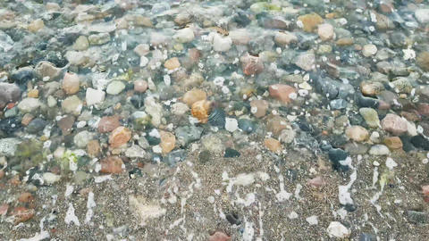 Waves on the beach with stones Footage