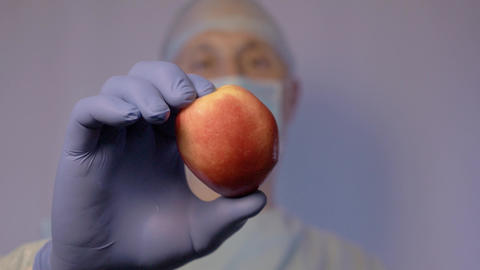 The doctor shows the patient nectarine. Calls for a healthy diet. Take natural Footage