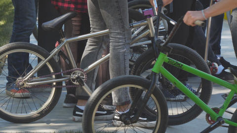 Group of teenagers with bicycles in the Park Live Action