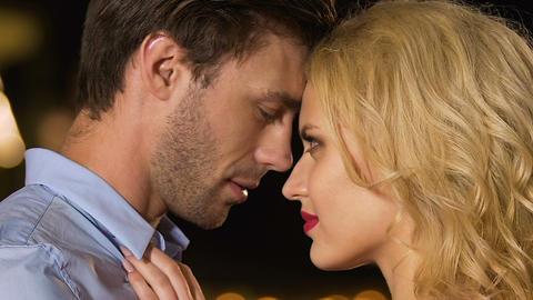 Beautiful blond woman seducing wealthy man, enchanting seduction, femme fatal Live Action