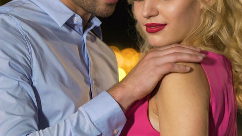 Couple caressing each other tenderly, safe sexual relationship, contraception Footage