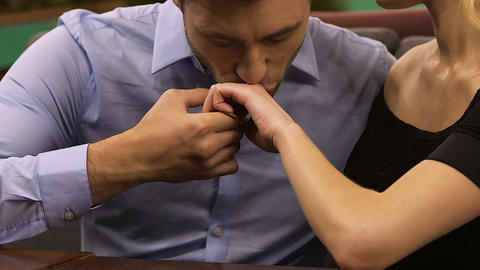 Romantic couple sitting in cozy restaurant, man kissing hand of woman, courtship Footage
