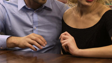 Man trying to take upset offended girlfriend by hand, conflict in relationship Footage