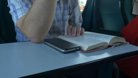 Man Reading Book in Train Footage