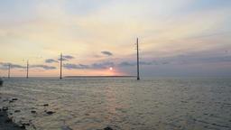 Islamorada, Florida Keys, horizon with sun, island, clouds moving, waves Footage