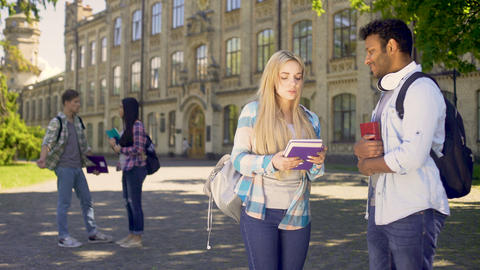 Cheerful mixed-race students actively communicating with each other, friendship Live Action
