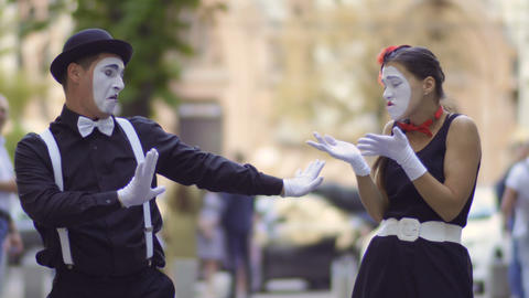 Friendly man mime give his girlfriend a jacket for warm her Footage