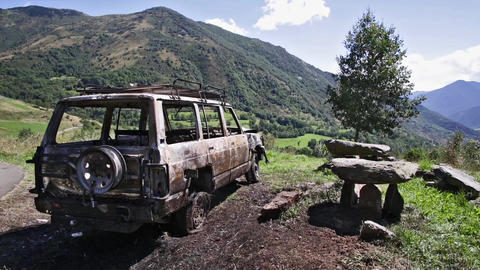 Car that has burned in the middle of nature Live Action