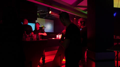 Crowd dancing in a night club with electronic dance music techno dj Footage