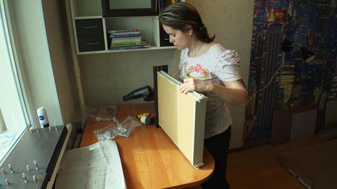 Girl repairing furniture. 4K Stock Video Footage