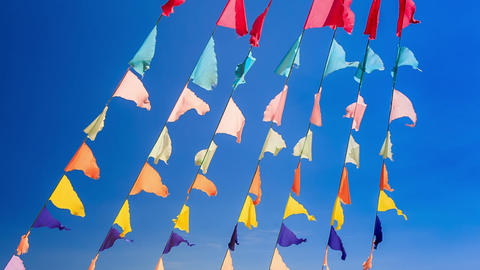 Closeup Garlands of Colourful Flags Sea Blue Sky Footage