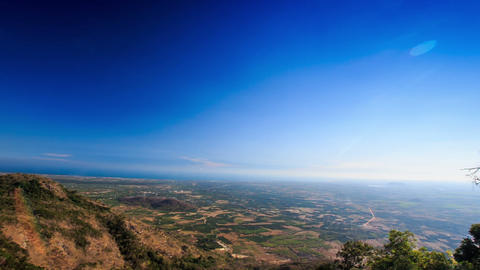 View of Tree Tops and Valley from Hill and Blue Sky Footage
