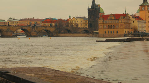 Approaching a Lock in Vltava River with Charles Bridge in Prague, Czech Republic Footage
