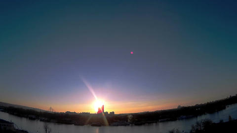 Sun going behind the building time lapse Footage