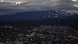 Summer nighttime Petropavlovsk Kamchatsky City on background of volcano ビデオ