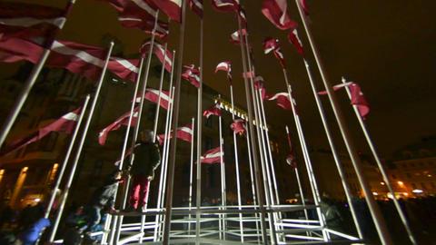 Many Flags of Latvia on 18 of November day celebration light festival Staro Riga Footage