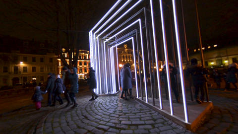 Arc of white LED light with timer on STARO RIGA night life festival Footage