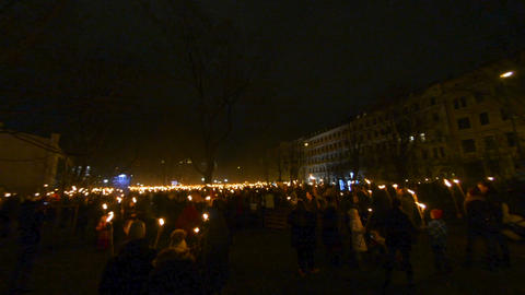 A lot of people with fire torches, Independance day celebration in Riga, Latvia ビデオ