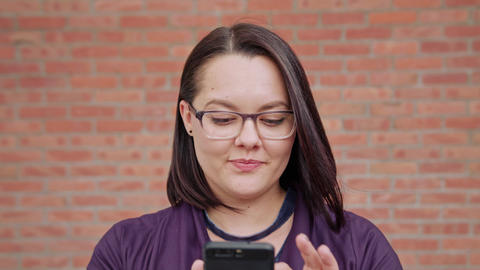 Young Lady wearing Glasses Using Phone Live Action
