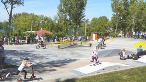 Cyclists ride bicycles on a velodrome in the park Live Action