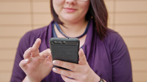 Young Lady wearing Glasses Using Phone Footage