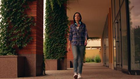 slow motion of a woman walking along the passage 영상물