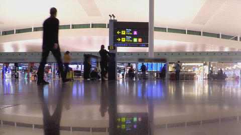 People Crowd In Bright Airport Terminal Interior Footage