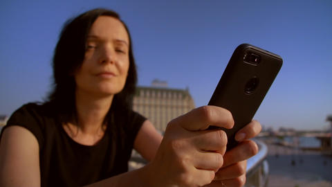 close-up of a woman using her mobile phone GIF