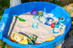 Plastic children toys for playing in sandpit or on a beach Photo