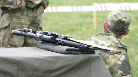 Weapon machine guns and soldiers in the summer on the grass Live Action