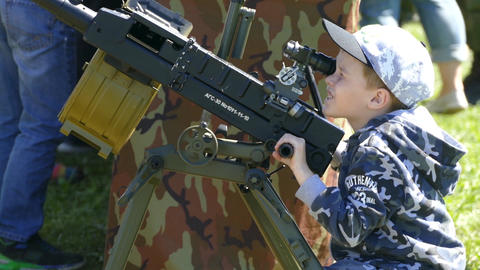 A boy shoots a gun at an exhibition Footage