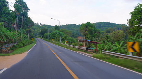 trip along an asphalt road in Thailand. tropical asia, palm trees along the road Footage