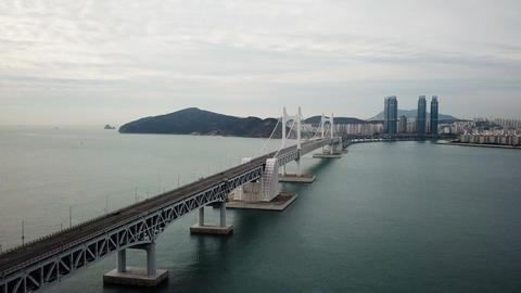 Gwangan Bridge and Haeundae aerial view at Busan City, South Korea Live Action