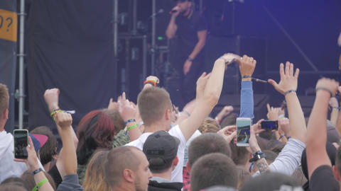 Young crowd of teenagers dancing at a music festival in summer Footage