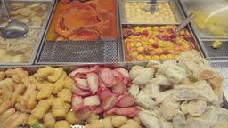 Smooth panning shot of Hong Kong street food at food stall Footage