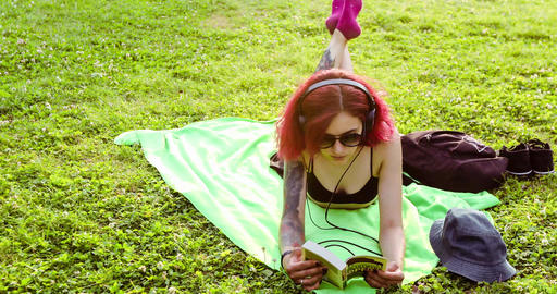 Girl Relaxing and Reading a Book in Park Grass Footage