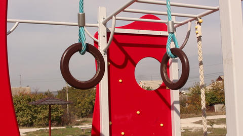 Hands on gymnastic rings. Playground. Horizontal bar with the rope ビデオ